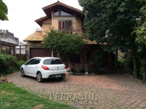 TerraSul Imóveis - Casa 3 Dorm, Ipanema (IPA7724)